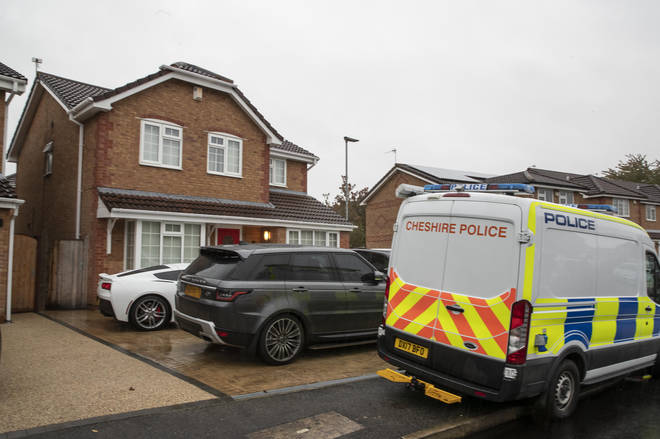 Police outside the house of a couple in Warrington