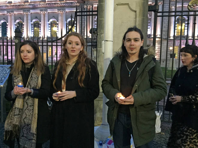 People take part in a vigil outside Belfast City Hall for the 39 people found dead inside a lorry in Essex