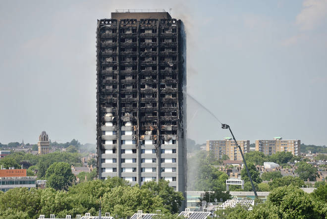 Firefighters spraying water after the fire engulfed Grenfell Tower in west London