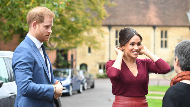 The Duke and Duchess of Sussex pictured together this week at a talk on gender equality at Windsor Castle