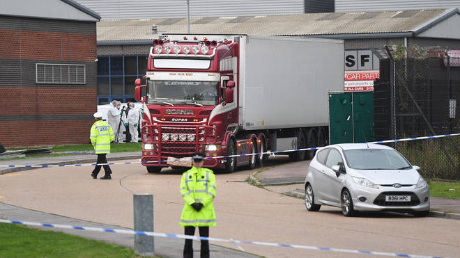 Forensic officers investigate the lorry in Grays, Essex
