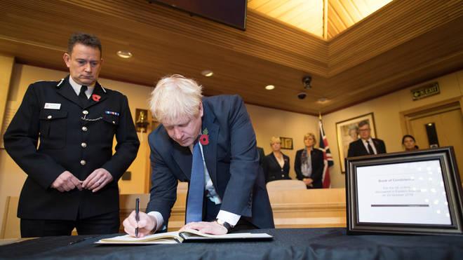 Mr Johnson signed the condelence book alongside Home Secretary Priti Patel