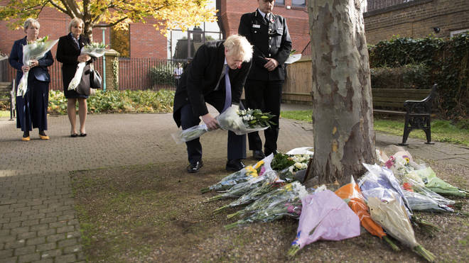Mr Johnson laid flowers in a memorial garden for the 39 victims