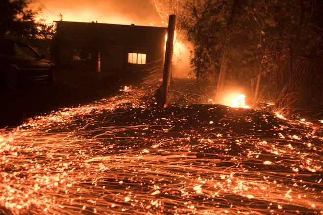 Thousands of little spot fires burn from wind driven embers in Healdsburg, California