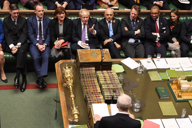 The Prime Minister gesticulates at Jeremy Corbyn in the Commons
