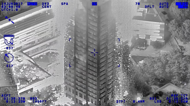 An infra-red photo from a police helicopter showing  burning debris falling from the tower block, police officers used riot shields to protect firefighters on the night of the fire