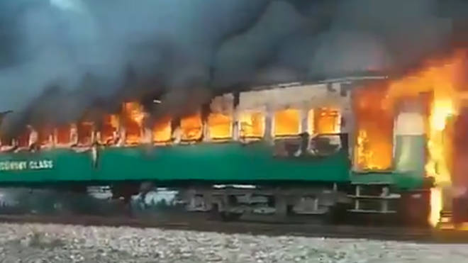 More than 60 people have died after an exploding gas canister caused a train to burst into flames