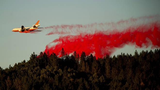 An air tanker drops retardant while battling the Kincade Fire near Healdsburg, Calif.