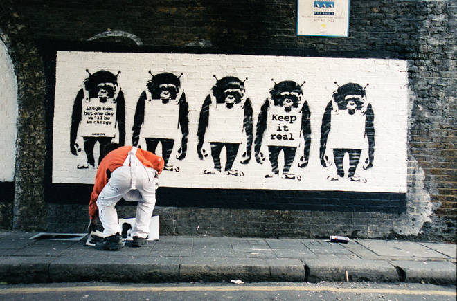 Photographs Show Banksy at work for the first time