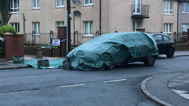 A car was seen covered at the scene the morning after the incident