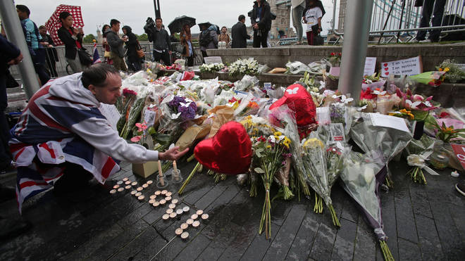 Floral tributes were laid in Potters Fields Park