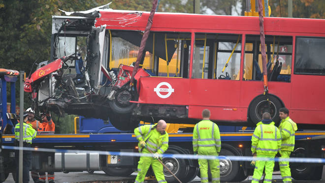 The bus is removed from the scene of the crash in Orpington