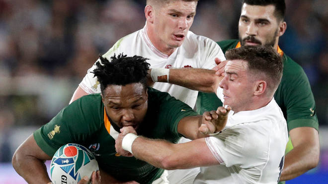 South Africa's Lukhanyo Am is tackled by England's Owen Farrell and George Ford during the Rugby World Cup final