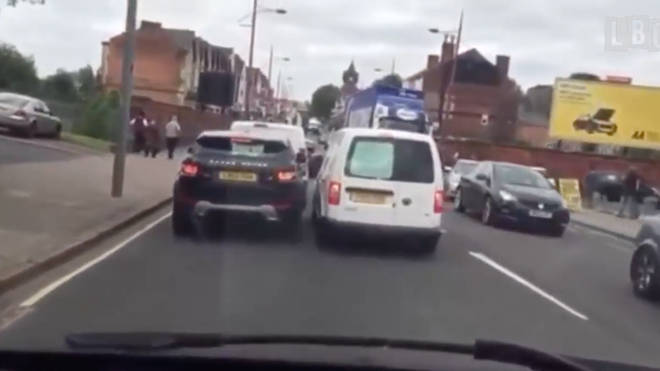 A squabble between two motorists escalated as one gets punched in the face.