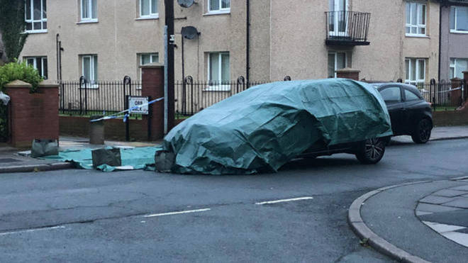 A car was seen covered at the scene the morning after the incident.