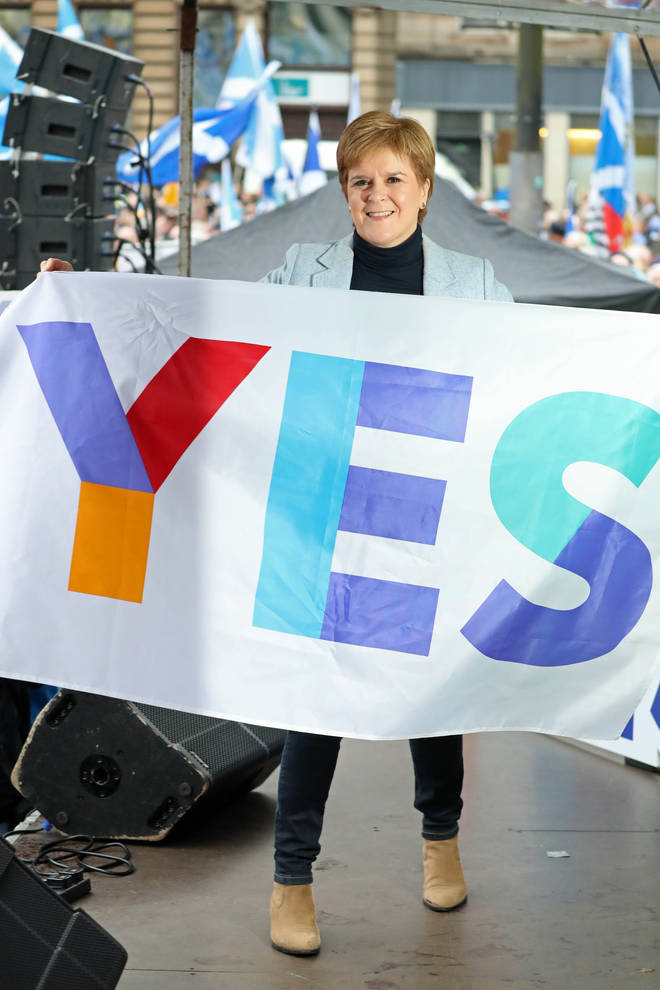 Nicola Sturgeon with a Yes to independence sign