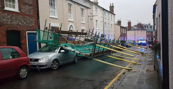 A car has been crushed in Dorset after scaffolding collapsed.