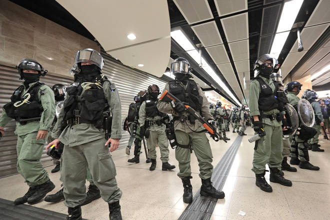 Riot police form a line at a shopping centre in Hong Kong