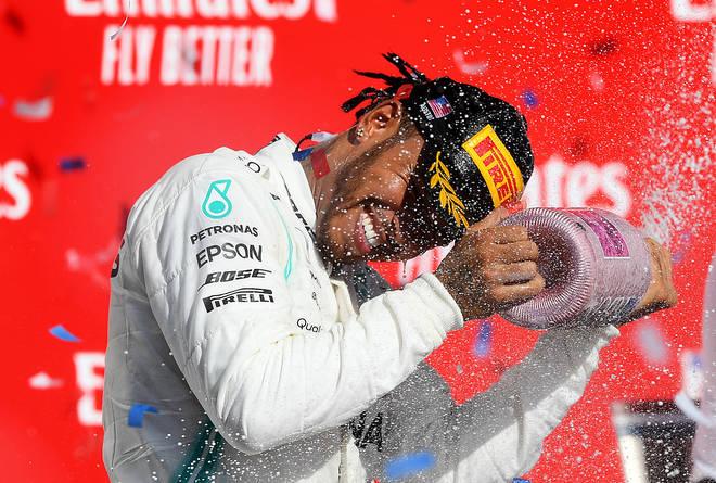 Lewis Hamilton celebrates on the podium during the US F1 Grand Prix