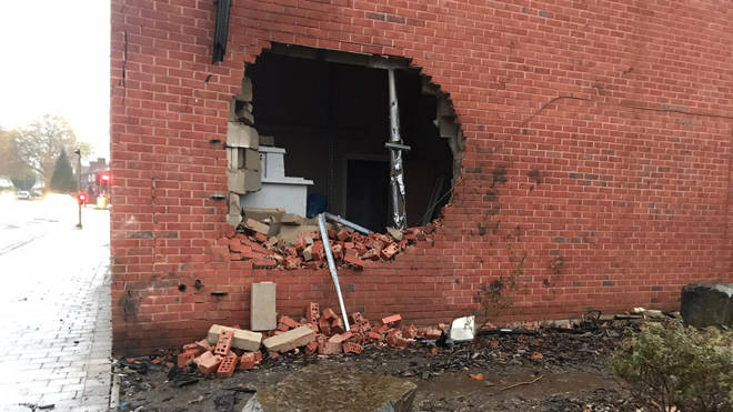 The car punched a hole in the wall of a building in Burnage, Manchester