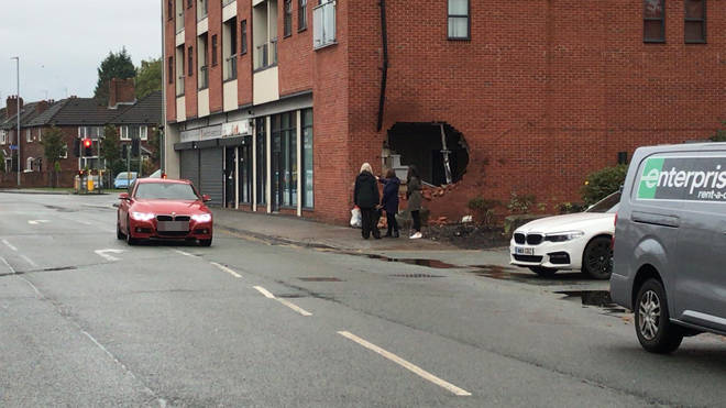 The hole in the wall at the scene of the fatal crash in Burnage