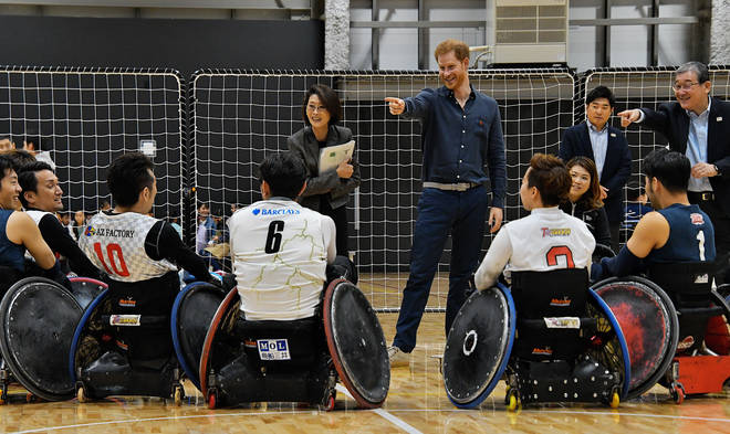 Prince Harry speaks with para athletes during the wheel-chair rugby training session at the Para Arena in Tokyo, Japan