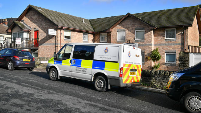 A police vehicle outside Ashville Ashville Residential Care Home in Brithdir, South Wales