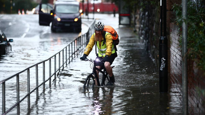This cyclist struggled through flood water in Sheffield