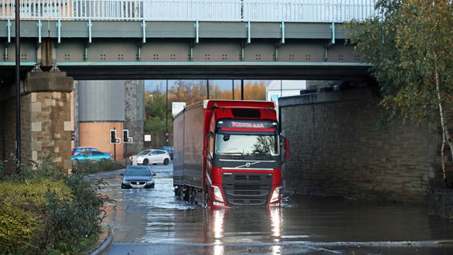 A lorry makes its way through floodwater in Sheffield