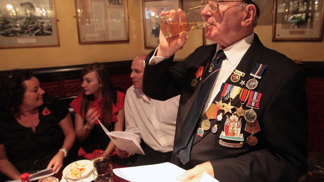 War veterans held their annual 'sing song' after Remembrance Sunday at the Sherlock Holmes pub off Whitehall in London