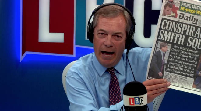 Nigel Farage holds a copy of today's Daily Mail
