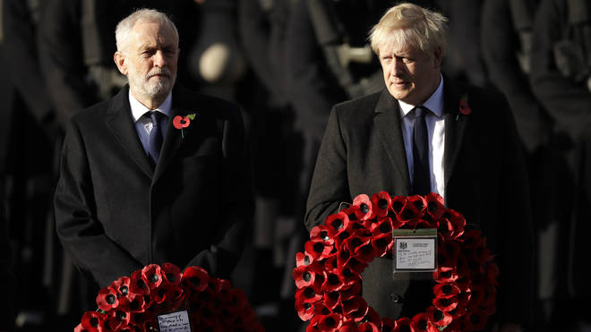 Boris Johnson and Jeremy Corbyn stand side-by-side at the remembrance service