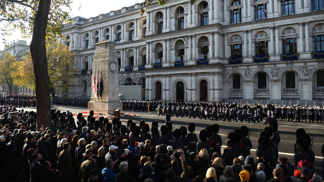 Veterans and members of the public honour servicemen and women at the Cenotaph in London