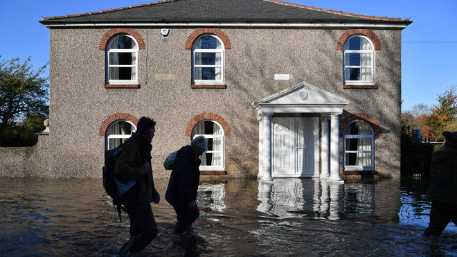 Residents of Fishlake, Doncaster wading through floodwater