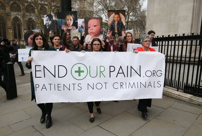 Medical cannabis campaigners in Westminster before handing in a petition in at 10 Downing Street, London