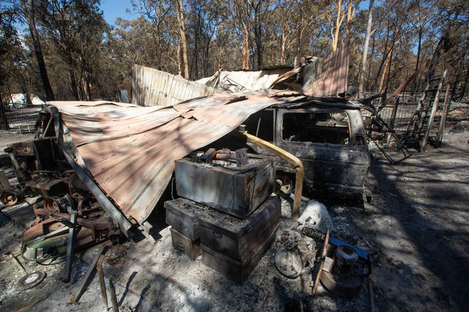 Damage caused by bushfire is seen at resident Brian Williams' resort at Lake Cooroibah Road in Noosa Shire