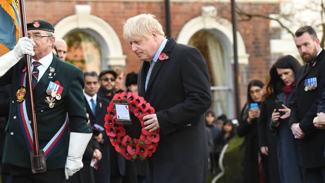 Boris Johnson lays a wreath in Wolverhampton