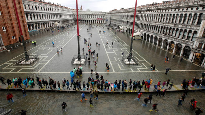 St Mark's Square was left totally submerged by flood waters
