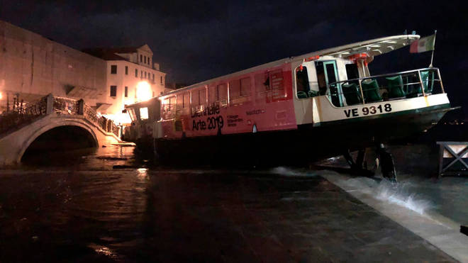 One of the city's famous waterbuses was upended by flood waters