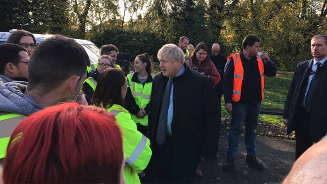 Boris Johnson visiting a centre for sorting food donations for the cut off village of Fishlake