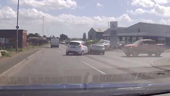 The moment a Mini gets flung into the air after colliding with another car.