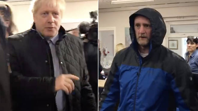 Boris Johnson was heckled as he visited the flooded area