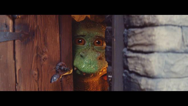 Excitable Edgar peers through the door