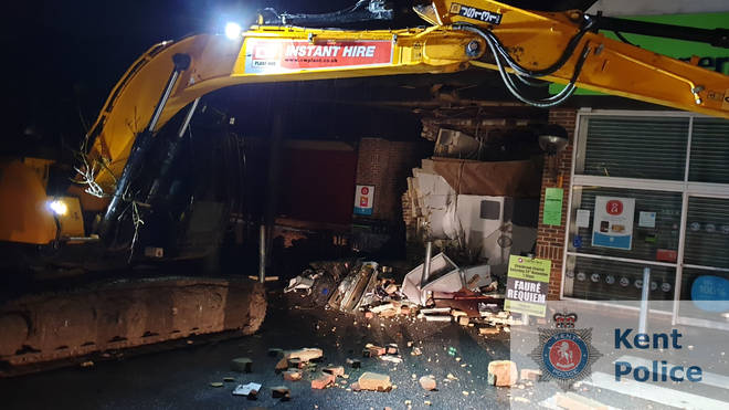 The digger smashed into the Co-op store in Cranbrook