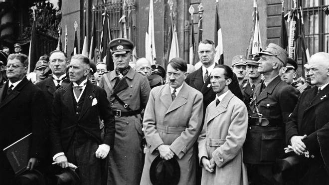 Adolf Hitler standing with Reich Propaganda Minister Joseph Goebbels in 1933.