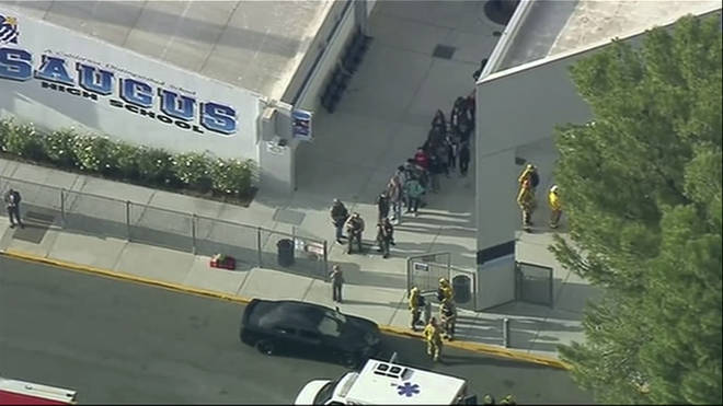 Students are led out of Saugus High School in California following a shooting