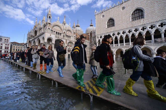 Much of Venice was left under water after the highest tide in 50 years ripped through the historic Italian city