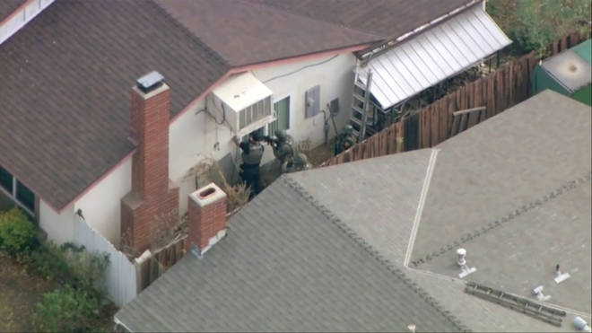 Officers searched a home in the wealthy suburb outside Los Angeles