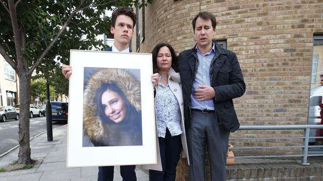 Nadim and Tanya Ednan-Laperouse, with their son Alex, holding a picture of Natasha