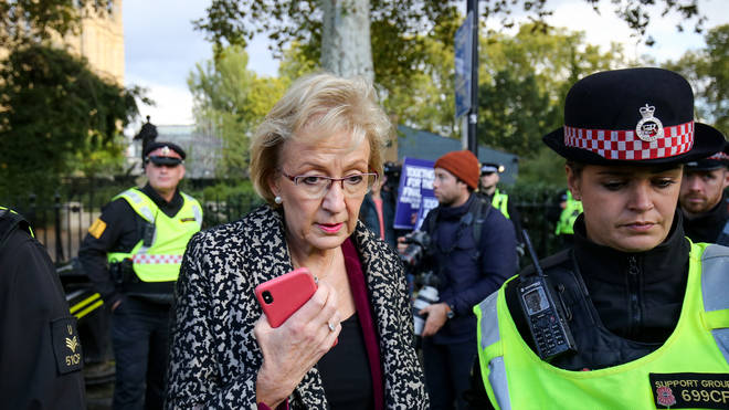 Add to lightbox Brexit Business Secretary Andrea Leadsom is escorted by police officers in Parliament Square, London, during an anti-Brexit, Let Us Be Heard rally
